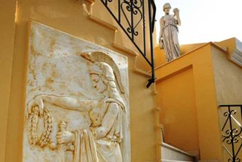 The external marble friezes and statues give the hotel a Neo-Classical look